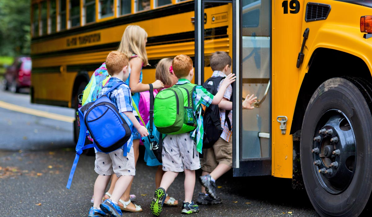 Kids getting inside School bus